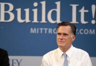 Republican presidential candidate, former Massachusetts Gov. Mitt Romney hosts a small-business roundtable during a campaign stop at Endural LLC,...
