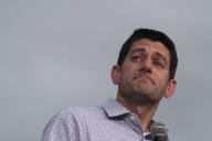 Republican vice presidential candidate Rep. Paul Ryan R-Wis., reacts to audience applause during a campaign event at the Waukesha county expo...