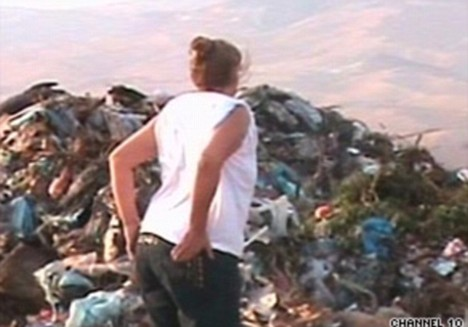 Desperate search: The woman searches a landfill in Tel Aviv for the missing mattress