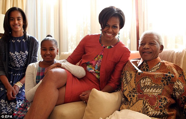 Visit: Mrs Obama also took her daughters to visit Nelson Mandela, which she called 'surreal'