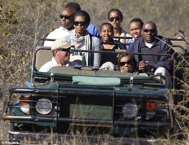 Play time: Mrs Obama, her daughters Sasha and Malia and her mother Marian Robinson enjoyed a safari in Madikwe Game Reserve during the trip