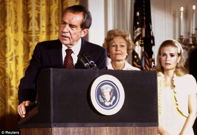 President Richard Nixon (left) says goodbye to family and staff in the White House East Room on August9,1974
