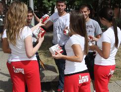 In Louisville, Spalding University students serve as billboards for KFC's Double Down.