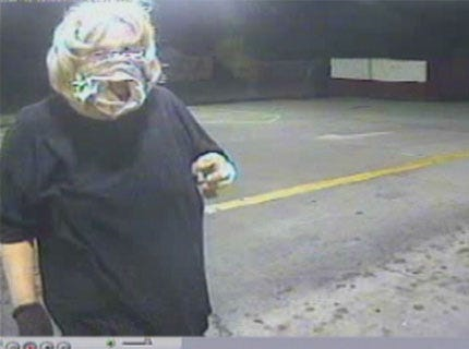 Police are looking for a woman who used underwear to cover her face.