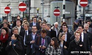 Commuters leave Waterloo Station, London