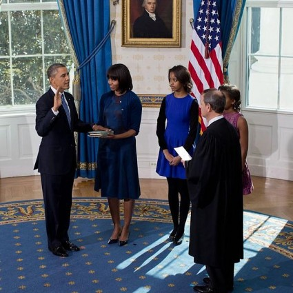 United States Supreme Court Chief Justice John Roberts administers the oath of office to President Barack Obama in the Blue Room of the White House on Inauguration Day